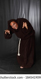 theatrical performance of a hunchback with black background
