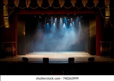 Theatrical scene without actors, scenic light and smoke