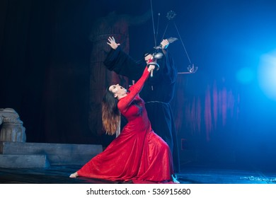 theatrical staging. Monk male and female beauty in a red dress. man women theater