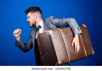 Theft of century. Delivery service. Travel and baggage concept. Hipster traveler with baggage. Baggage insurance. Man well groomed bearded hipster big suitcase. Thief run away with heavy suitcase.
