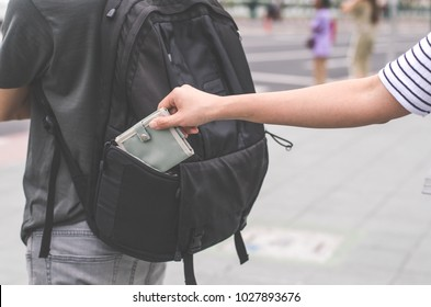 Theft of a purse from a pocket behind