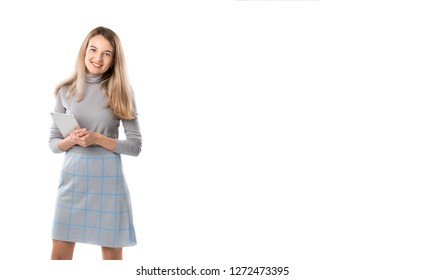 Theme business woman technology. Beautiful young caucasian blond woman in gray dress posing standing with tablet hands on white isolate background. Profession Marketer Sales Social Media Advertising.