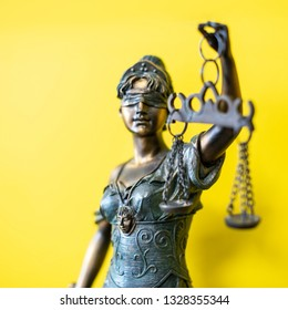 Themis Greek goddess of justice on yellow background