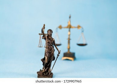 Themis statue on blue background