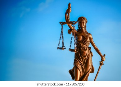 Themis statue on the sky background, symbol of law and justice. Law concept.