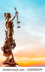 Themis statue, symbol of law and justice with sky background