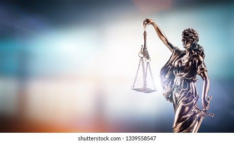 Themis, symbol of law on modern background. Court, legal system and justice.