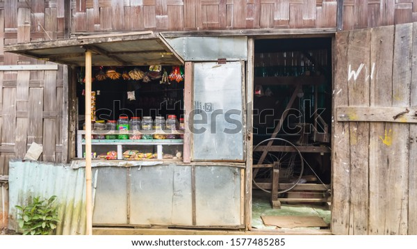 Thenzawl, Mizoram, India - November 2017: An old fashioned wooden weaving mill inside a grocery store made of wood and tin sheets in the Thenzawl market.