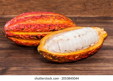 Theobroma Cacao - Organic Cocoa Fruit Of The Cocoa Tree; Photo On Wooden Background