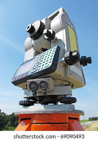 Theodolite staying on tripod, catch from below