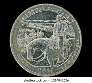 Theodore Roosevelt commemorative quarter coin isolated on black