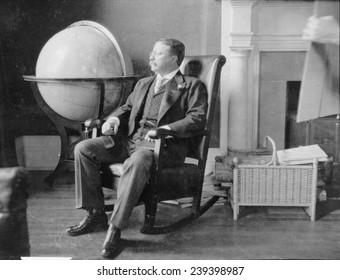 Theodore Roosevelt, at the end of his presidency, seated in rocking chair, by large globe. During Roosevelt's presidency, the United States was recognized as a world power.
