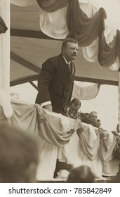 Theodore Roosevelt speaking at from a bunting draped platform in Worcester, Mass. From Aug. 22 through Sept. 3, made a speaking tour in New England