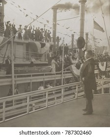 Theodore Roosevelt waving to passengers on another ship, from the deck of the SS Mississippi. Saint Louis, Missouri, Oct. 2, 1907. The Presidents three week Mississippi trip was designed to lobby for