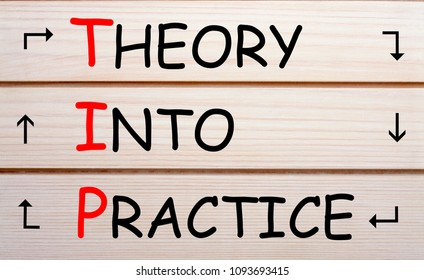 Theory Into Practice - TIP written on wood wall decor. Acronym concept.