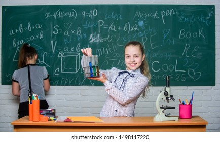 Theory and practice. Formal education school. Educational experiment. Back to school. School classes. Girls study chemistry in school. Biology and chemistry lessons. Observe chemical reactions.