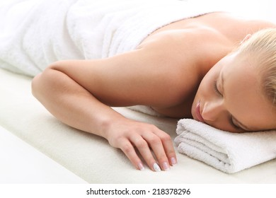 Therapeutic massage, heals the pain and relaxes . Attractive blonde woman in the office spa, relaxes August waiting for a cosmetic procedure.