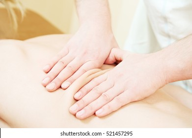 therapeutic massotherapy massage of human back against physical strain