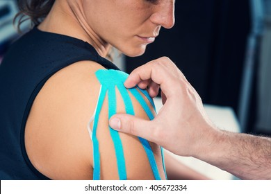 Therapeutic treatment of shoulder with kinesio tape