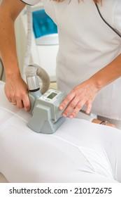 Therapist applying lipo massage LPG treatment