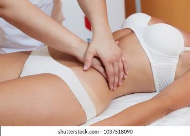 therapist - belly massage at spa salon