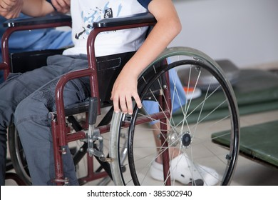 Therapist with boy in wheelchair