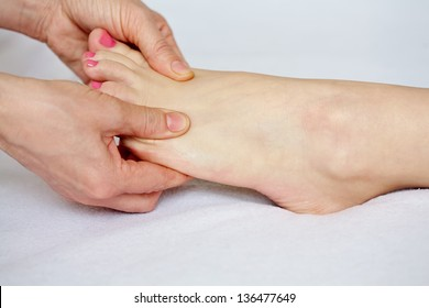 Therapist doing feet acupressure  massage