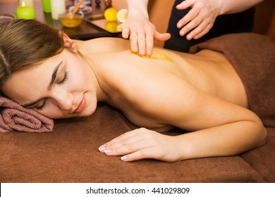 Therapist doing massage for beautiful young woman