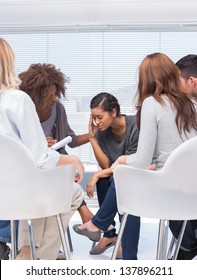 Therapist encouraging a patient at group therapy