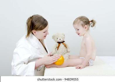 Therapist makes a child massage