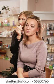 therapist making-up client's face