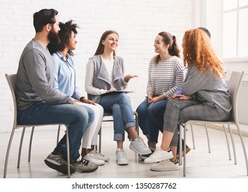 Therapist speaking to rehab group at therapy session, discussing problems and giving advices