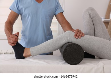 Therapist treating knee of athlete female patient , Physiotherapy, injury rehabilitation