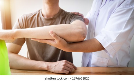 Therapist treating a male injured by rotator cuff stretching method, Physical therapy concept.