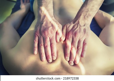 Therapy by acupuncture and hand massage