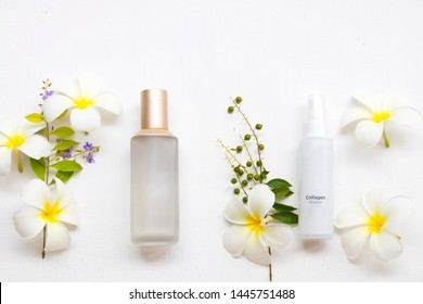 the therapy first serum toners ,collagen water spray and  cotton natural cosmetics extract herbal health care for skin face beauty of woman and flower frangipani arrangement flat lay style