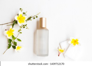 the therapy first serum toners with cotton natural cosmetics extract herbal health care for skin face beauty of woman and flower frangipani arrangement flat lay style on background white