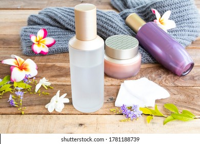 the therapy first serum toners with cotton ,eyes cream natural cosmetics extract herbal health care for skin face and knitting wool of lifestyle woman relax arrangement flat lay style on wooden