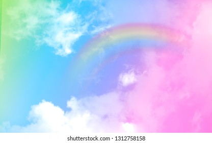 There are clouds and sky with rainbow as pastel background.