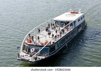 There is a cruise ship at the Han River in Yeouido Han River Park, and people are wearing masks and riding a cruise ship due to COVID-19. Seoul,South Korea 2021.02.27