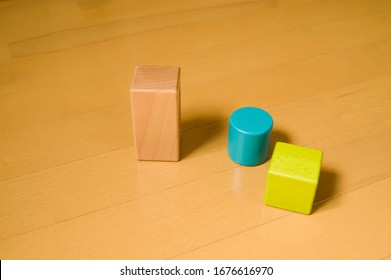 There are cubes, cylinders and rectangular blocks.