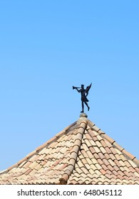There is decoration angel on the top of roof tile