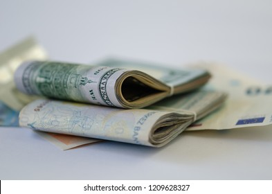There are dolar,euro and liras banknotes on the white background.