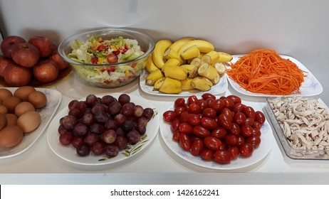 There are healthy foods on the table for the potluck party