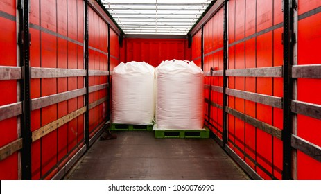 There is a loading to the truck trailer . Truck Trailer