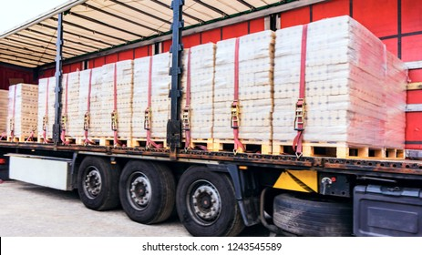 There is a loading to the truck trailer .  fastening of freight in the trailer .   transportation of freight Europe . industrial infrastructure . to fix freight .  Cargo container .