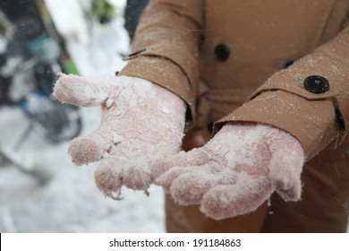 There is lots of snow on the gloves