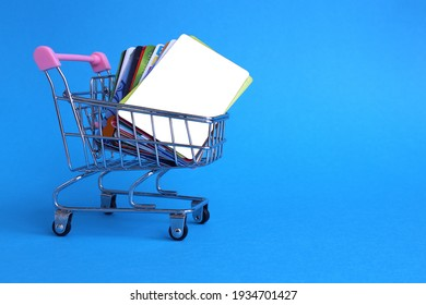 there are many credit cards in the shopping cart with space for text