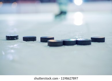 There are many pucks on the ice.