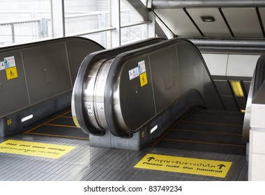 There are many warning markings on subway entrance to avoid accident from escalator in Thailand